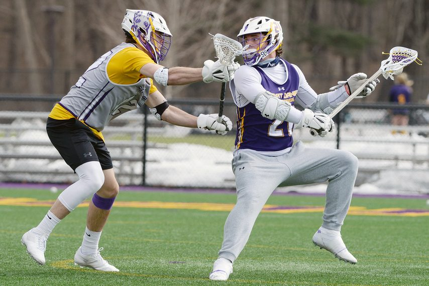 ERICA MILLER/THE DAILY GAZETTE UAlbany freshman attack Camden Hay, right, looks to shoot against the defense of Peter Schwab during practice on Wednesday.