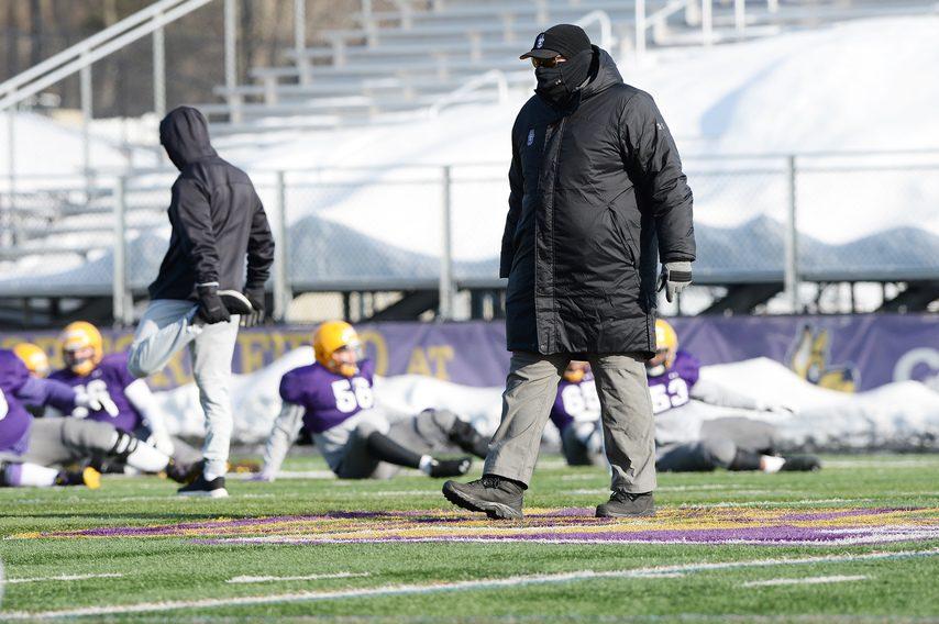 UAlbany football head coach Greg Gattuso walks the field at Tom & Mary Casey Stadium during a Feb. 17 practice.