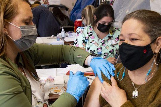 Miranda Vilma of Amsterdam gets her COVID-19 vaccination from Jessica Marotta at River Front Mallon Feb. 27.