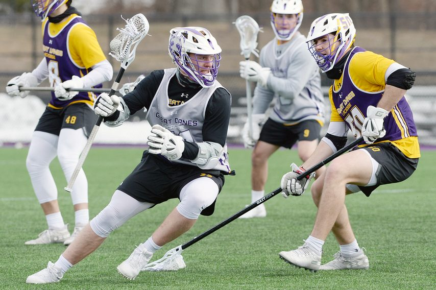 ERICA MILLER/THE DAILY GAZETTE UAlbany's Steven Kunz, right, defends Matt Eccles during practice on Wednesday.