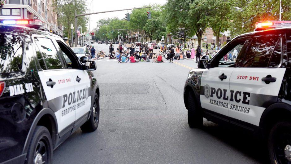 Protestors with 'All of Us' march in Saratoga Springs, shutting down Congress Street and Broadwayduring a protest on July 1.
