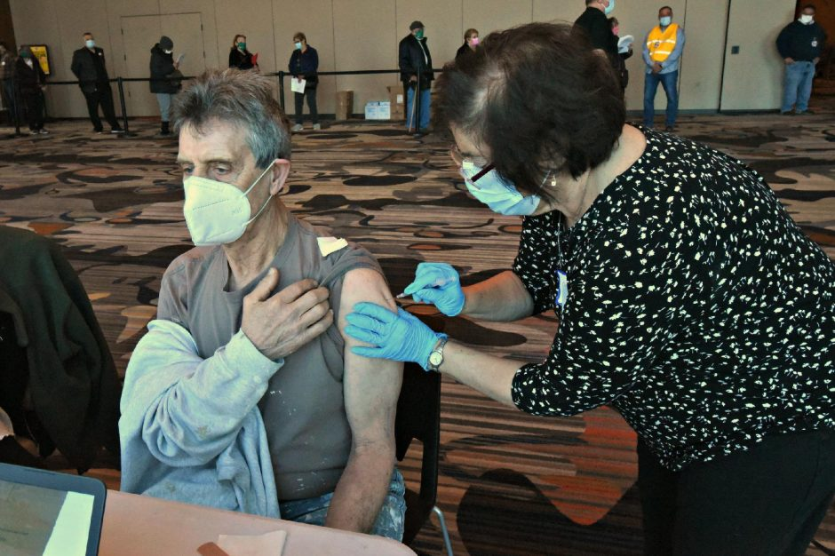 Joe Perretta of Schenectady receives his first of two Pfizer vaccinations Sunday morning from registered nurse Catherine Lucas of Niskayuna at Rivers Casino.