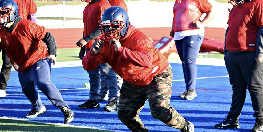 """Schenectady senior center Marquize Barmore participates in a blocking drill Sunday during the first """"Fall II"""" football practice for the Patriots at Larry Mulvaney Field."""