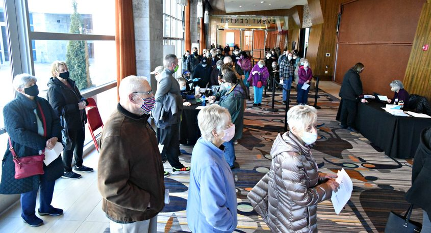 A crowd inside Rivers Casino events center awaiting entry Sunday morning for the mass vaccination event where more than 1,100 doses of the Pfizer vaccine were distributed to Schenectady County residents.