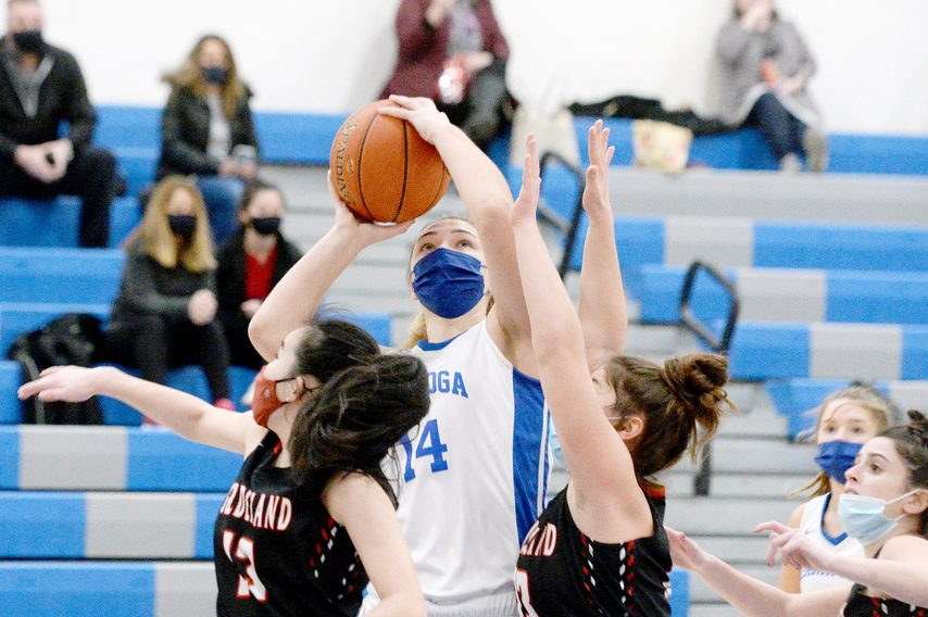 Tasha Chudy of Saratoga Springs takes a shot while Guilderland'€™s Grace McFerran and Sophia Serravillo defend during a Suburban Council tournament quarterfinal game at Saratoga Springs High School on Monday.