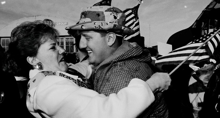 "Jayne Savage greets her son, Donald Savage III, from duty in the Persian Gulf during a ""welcome home"" ceremony at Stratton Air National Guard Base in Glenville on Wednesday, March 13, 1991."