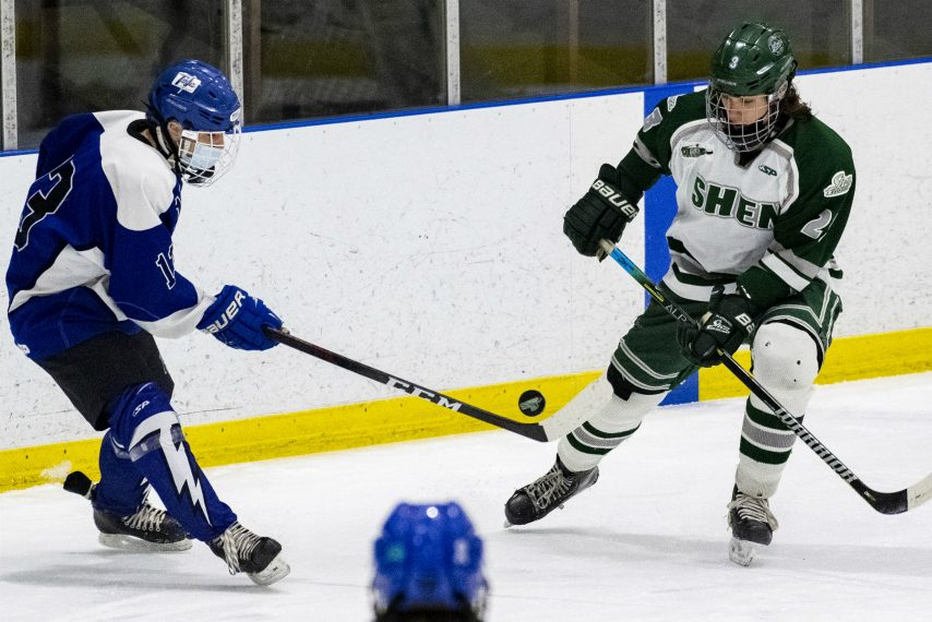 Ryan Dolan, left, and Shenendehowa's Calvin Hicks go after a loose puck Tuesday, February 16, 2021.