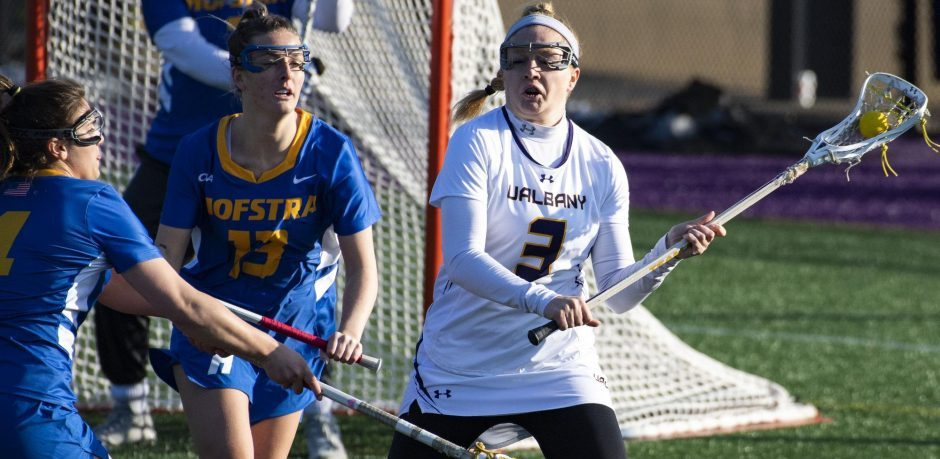 UAlbany's Madison Conway handles the ball next to Hofstra's Sabrina Cristodero and Erin Tierney during Tuesday's game at John Fallon Field.
