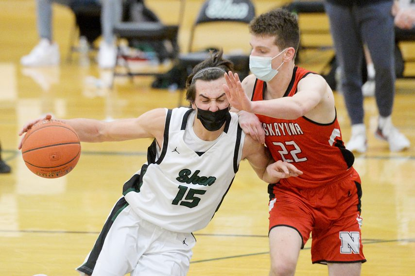 Mason Courtney of Shenendehowa drives against Niskayuna'€™s Owen Evens during Wednesday's Suburban Council tournament semifinal game at Shenendehowa High School..