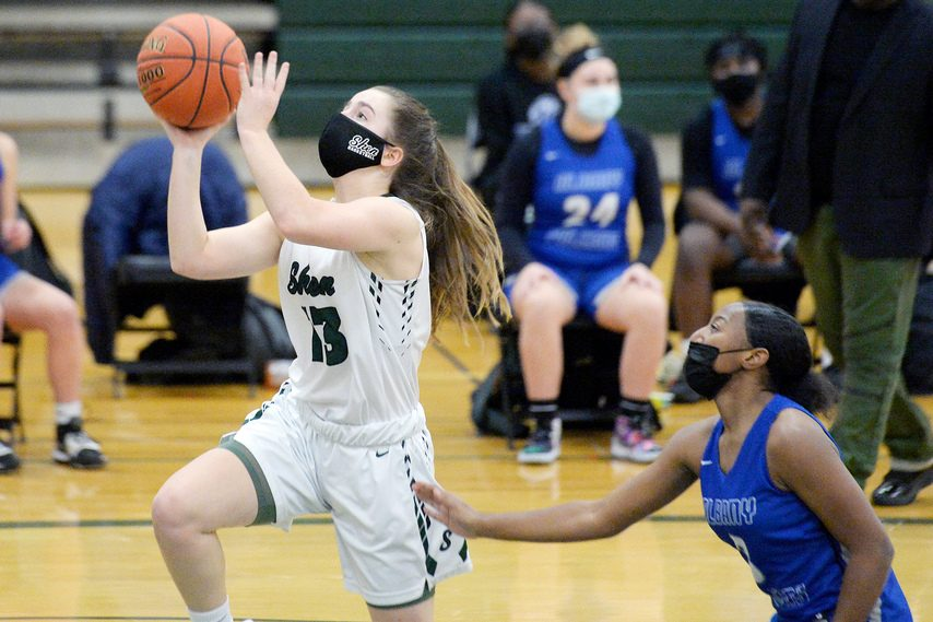 Shenendehowa'€™s Bri Carey takes a shot during Wednesday night's Suburban Council tournament semifinal game against Albany at Shenendehowa High School.
