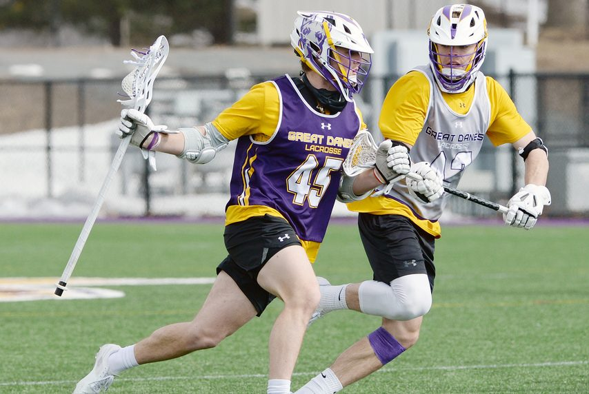 ERICA MILLER/THE DAILY GAZETTE UAlbany's Graydon Hogg, left, handles the ball against Peter Schwab during practice on March 3, 2021.