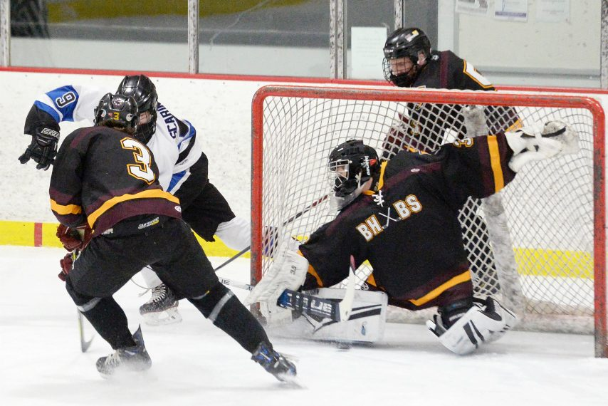 BHBS's goalie Alex Shear blocks the puck against Adirondack's Nate Scarincio during high school hockey semi-finals at Glens Falls Recreation Ice Center in Glens Falls on Friday, March 12, 2021.