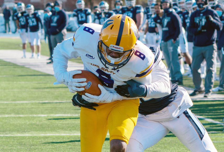 UAlbany wide receiver Chris Potts breaks through a tackle on his way to a touchdown against Maine on Saturday, March 13 at Alfond Stadium in Orono, Maine. (Photo courtesy Ronald Gillis/Maine Athletics)