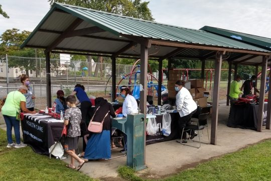 MVP Health Care distributes flu shots and back-to-school kits containing masks, sanitizer and school supplies at Jerry Burrell Park in Schenectady in September.