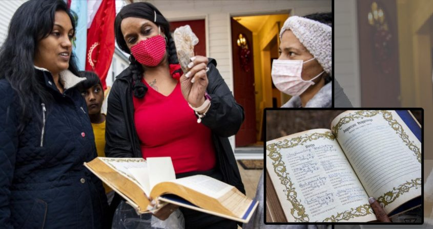 Teena Coney Pickett, center, shows Sridevi Nankishorelal, left, the black rose from her mother's funeral that she placedinside the bibleby Psalm 23 with Sondra Banks, right. Nankishorelal's daughter Veena, 5, looks on at far left.