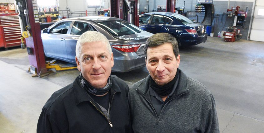 Owners of G&M Auto Tech Bob Garbellano (right) and Mike Rogan together Friday at their shop.