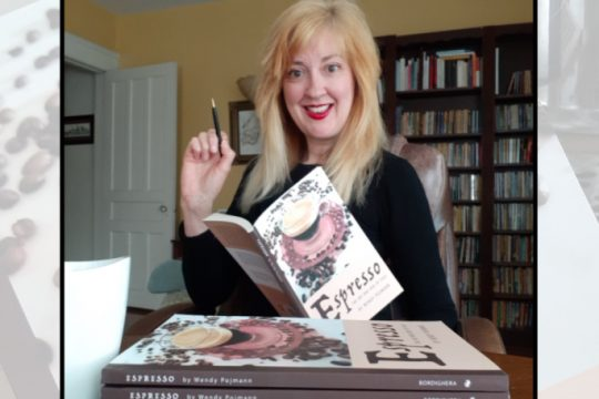 Wendy Pojmann with her book