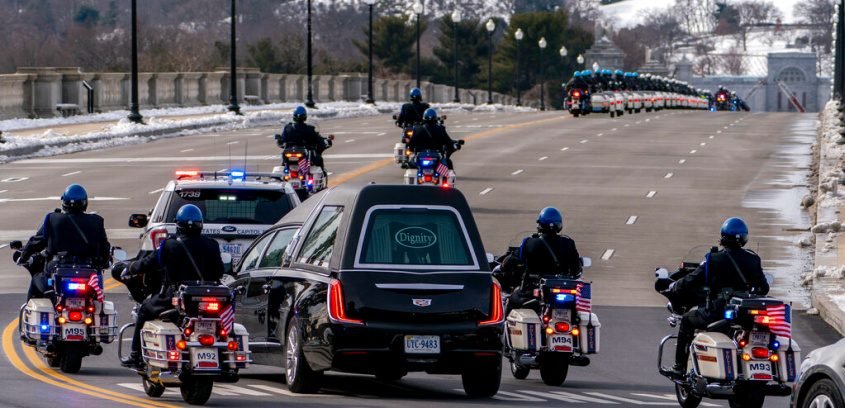 a hearse carrying the remains of U.S. Capitol Police officer Brian Sicknick makes its way to Arlington National Cemetery Feb. 3