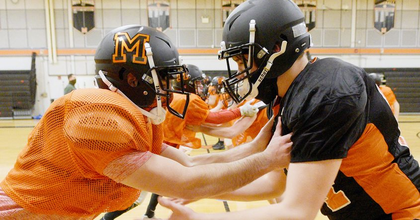 Mohonasen's quarterback senior Tyler Reinke (left) and junior Nick Leach during football practice in preparation for first home game against Niskayuna on Saturday at Mohonasen High School on Monday, March 15, 2021.