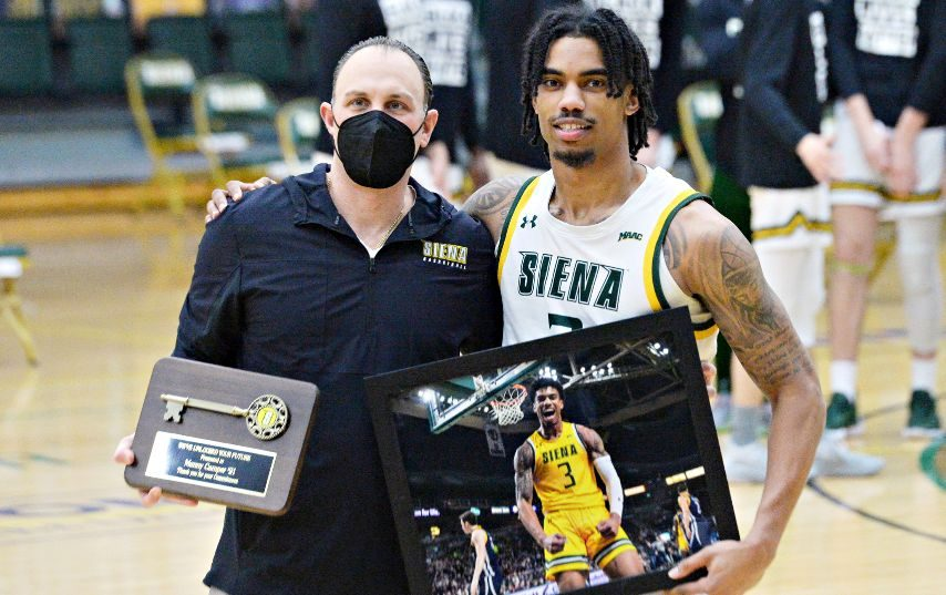 Siena's Manny Camper, right, is shown with coach Carmen Maciariello on senior night earlier this year.