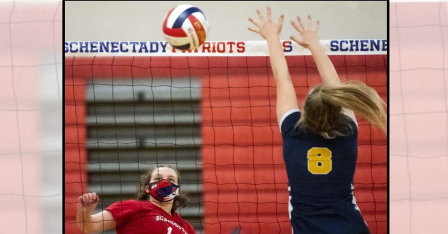 Schenectady's Shannon McCloskey scores a point over Averill Park's Isabella Mahar during Tuesday's Suburban Council girls' volleyball match at Schenectady High School.