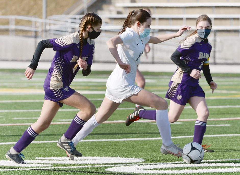 Ballston Spa's Makayla Kruzinski runs with the ball between Amsterdam's Jamie Dawson and Nicole Turney during Wednesday's non-league girls' soccer game at Lynch Literacy Academy.
