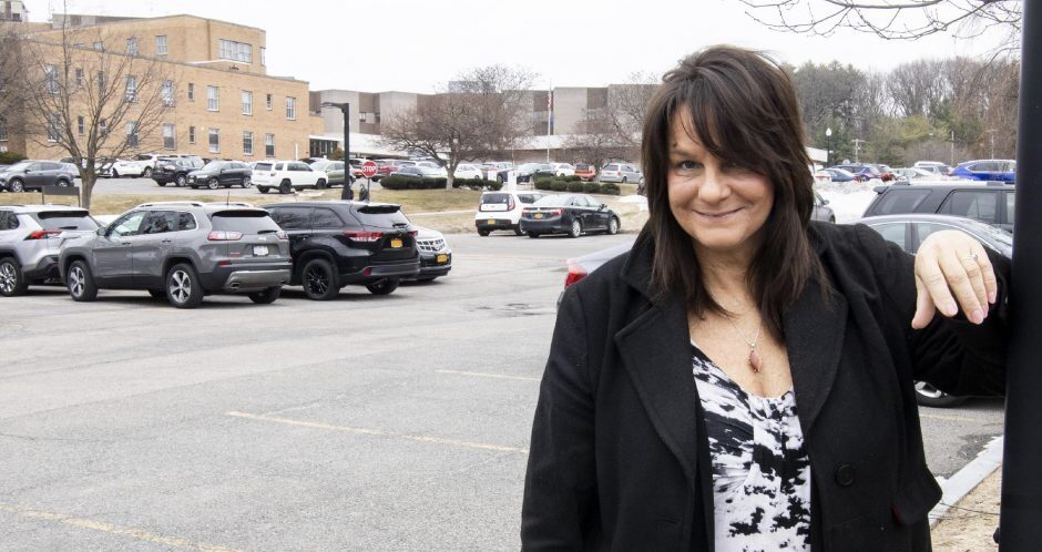 Ginni Eagan stands in the former St. Clare's Hospital parking lot on Wednesday.