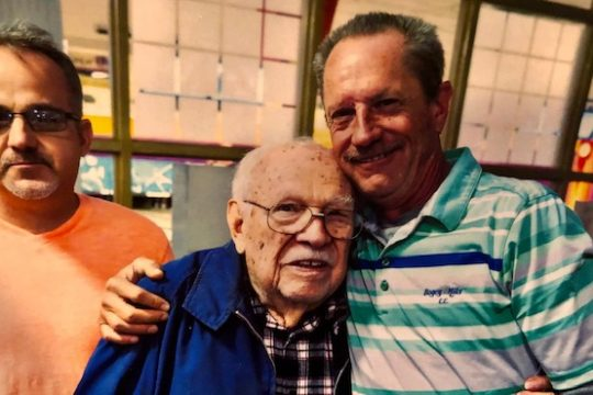 Frank Cornicelli, center, gets a hug from PBA Tour legend Pete Weber. At left is Schenectady USBC board member Chet Ciembroniewicz.
