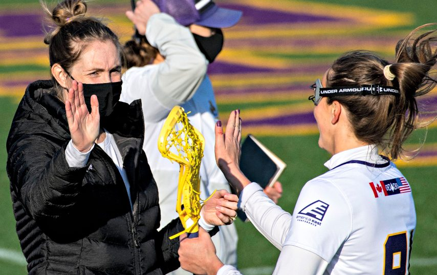 Katie Rowan Thomson, left, and the UAlbany women's lacrosse team competes Saturday against Stony Brook.