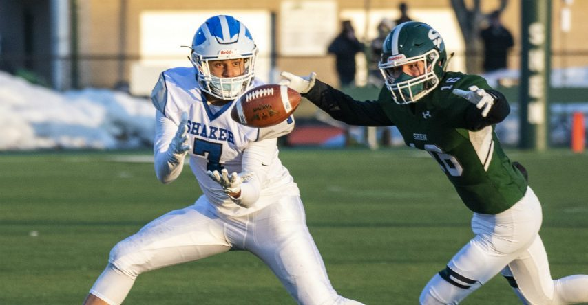Shaker's Malcolm Robinson pulls in a reception next to Shenendehowa's Jake Stack Friday, March 19, 2021.