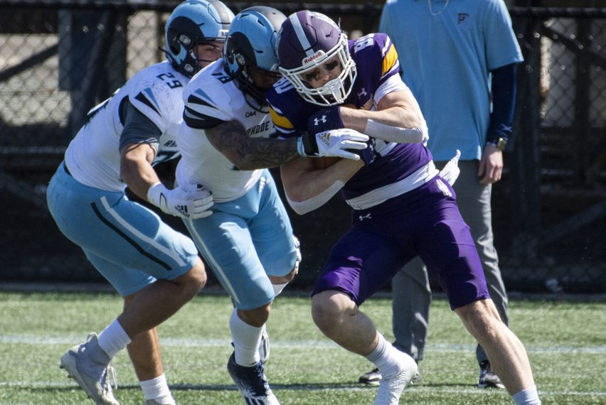 UAlbany football's Mike Gray is wrapped up by Rhode Island's Henry Yianakopolos and Coby Tippett during Saturday's game at Tom & Mary Casey Stadium in Albany.