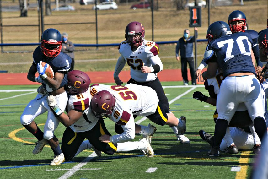 Schenectady's Chris Davis looks to break free behind the line of scrimmage Saturday afternoon against Colonie in Class AA football action at Schenectady High School. March 20, 2021.