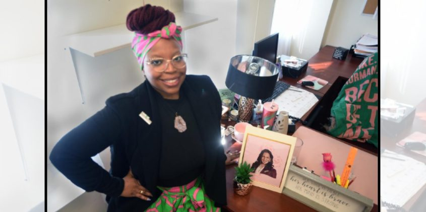 Nikita Hardy, Schenectady County Affirmative Action Manager and the Schenectady County Human Rights Commissioner in front of her desk