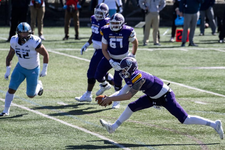 UAlbany football quarterback Jeff Undercuffler lunges for extra yardage during Saturday's game against Rhode Island at Tom & Mary Casey Stadium in Albany.