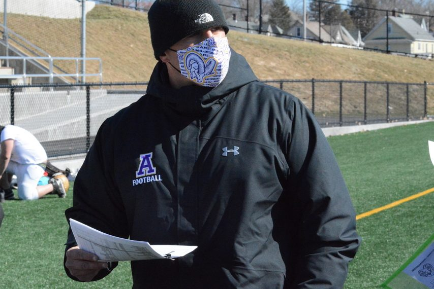Amsterdam head coach John Homich walks the sideline during football practice on Monday, March 15, at Lynch Literacy Academy.
