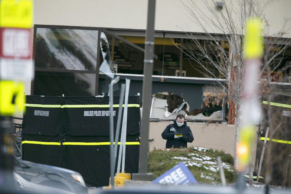 Police work on the scene outside of a King Soopers grocery store where authorities say multiple people were killed in a shooting, Monday in Boulder, Colo.