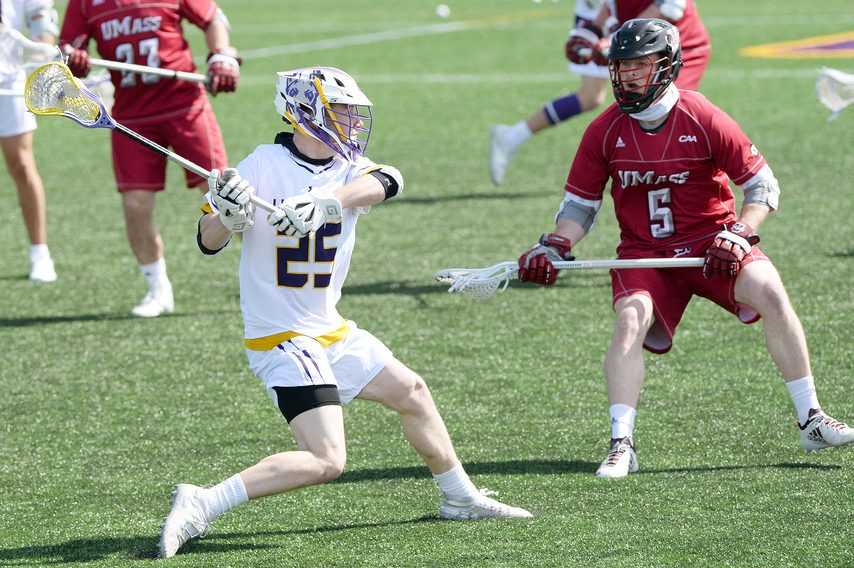 ERICA MILLER/THE DAILY GAZETTE UAlbany's Chris Ryan (25) looks for an opening against Charlie O'Brien of UMass at Fallon Field on Tuesday.