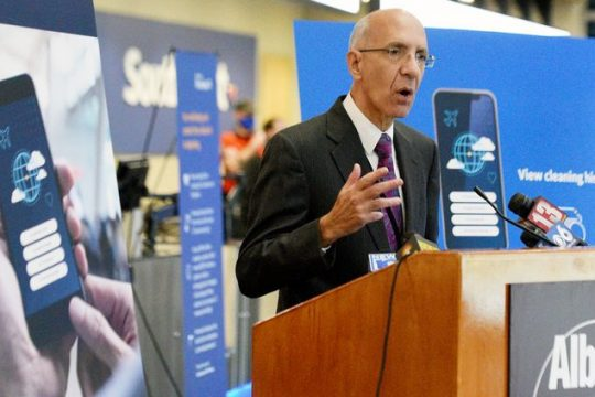 Albany County Airport Authority CEO Philip Calderone on Nov. 12 shows a new phone app that tracks COVID-19 cleaning protocols at the airport.
