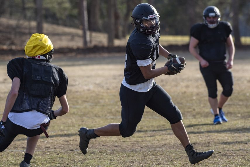 Holy Trinity senior Todd Williamson runs a play during practice Tuesday at Notre Dame-Bishop Gibbons High School.
