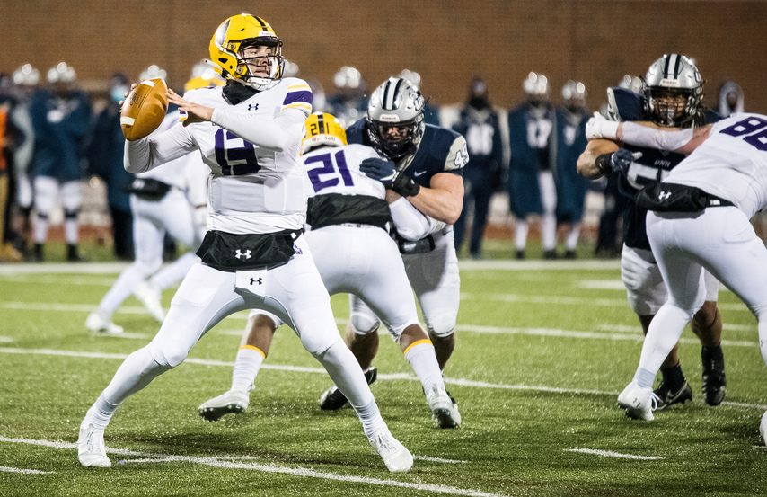 UAlbany quarterback Jeff Undercuffler passes against New Hampshire during a CAA football game on Friday, March 5 in Durham, New Hampshire. (Photo courtesy China Wong/UNH Athletics)