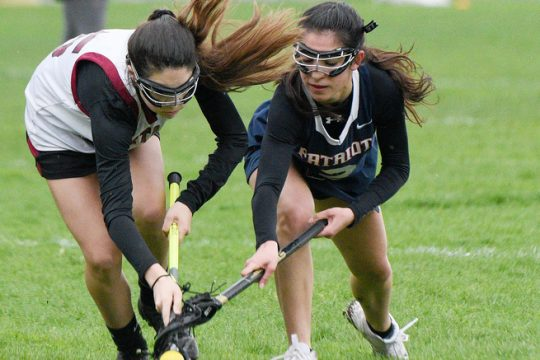 Scotia-Glenville's Brooklyn Dryo, left, and Christina Esposito of Schenectady/Mohonasen go after the ball during a lacrosse game from the 2019 season.