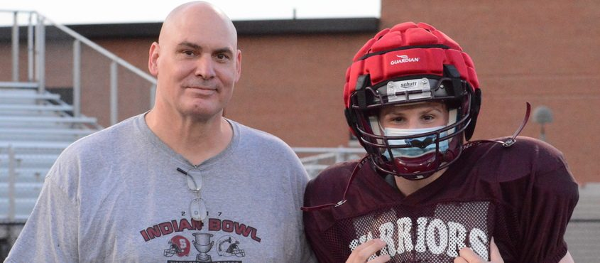 Stillwater football assistant coach and former NFL offensive lineman Joe Cocozzo (left) and his son, Stillwater offensive lineman Anthony Cocozzo, are pictured at practice on Tuesday, March 23 at Stillwater High School.
