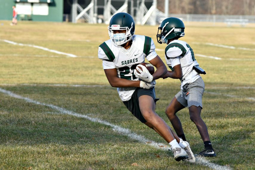 Rodney Parker turns up the field after a handoff from quarterback Trent Randle during Tuesday's practice at the Schalmont High School football practice field. March 23, 2021.