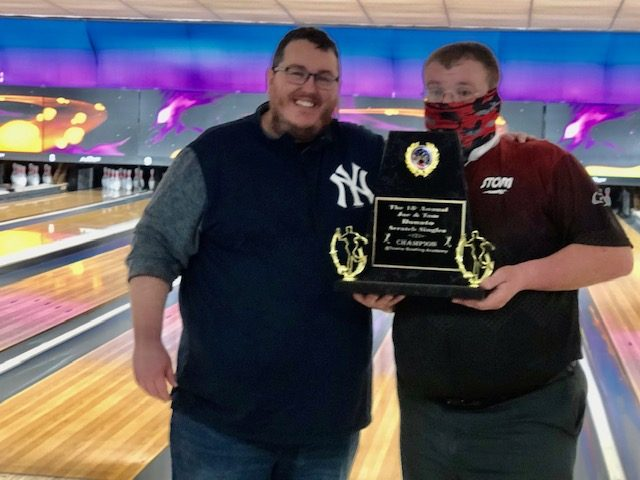 Winner Phil Drumm, right, of the Binghamton area accepts the trophy from Tommy Donato after winning the 18th annual Donato Scratch Singles tournament Sunday at Towne Bowling Academy.