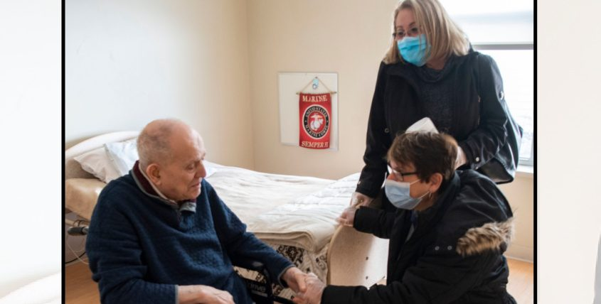 Glendale Home resident Jerry Legorius is visited by his daughters Joan Duell of Clifton Park and Beth Miceli of Rotterdam in Glenville Feb. 26