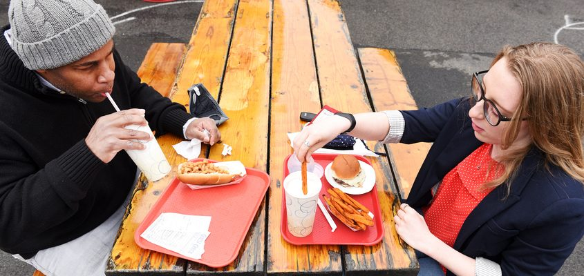 Daily Gazette reporters Brian Lee and Shenandoah Briere, both new to the area, enjoy their meal on opening day at Jumpin' Jack's Drive-in in Scotia on Thursday.