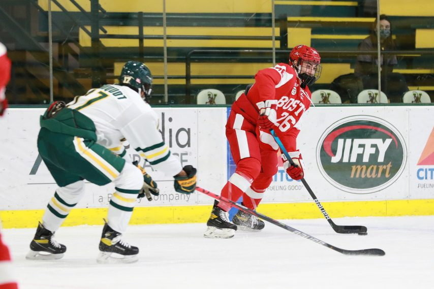 BU ATHLETICS Union transfer Joseph Campolieto, right, handles the puck for Boston University against Vermont on Feb. 12.