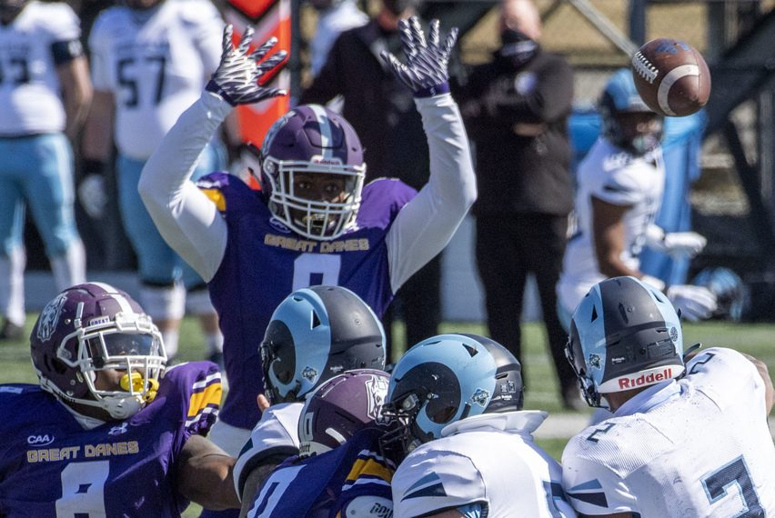 UAlbany's Anthony Lang knocks down a pass during last Saturday's game against Rhode Island at Tom & Mary Casey Stadium in Albany.