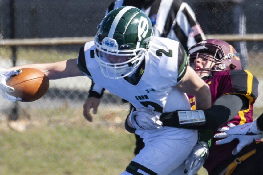 Shenendehowa's Kyle Acker out stretches his arm to break the plane of the goal line for a touchdown while being wrapped up by Colonie's Thomas Davis Saturday, March 27, 2021.