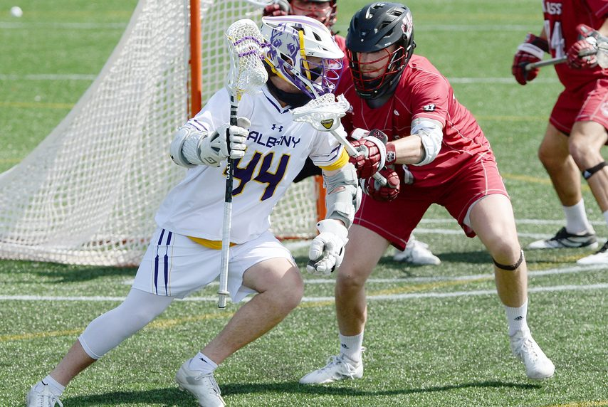 ERICA MILLER/THE DAILY GAZETTE UAlbany freshman Logan Tucker (44), shown against UMass on Tuesday, scored four goals in a 16-10 loss to Stony Brook on Saturday.